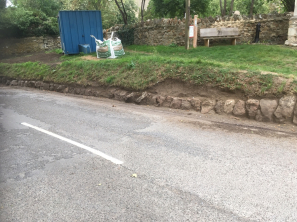 Kerb sarsens being revealed and reinstated