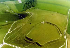 Uffington Castle viewed from the west with Dragon Hill top-left and the White Horse to its right. Photo courtesy English Heritage.